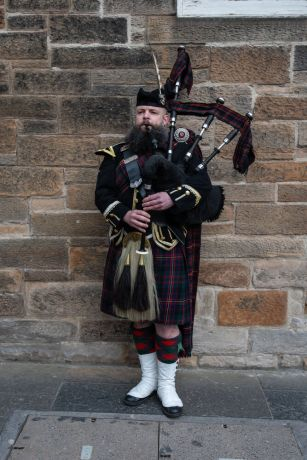United Kingdom: Bagpipe player Scotland.  Photo by Garrett N More Info