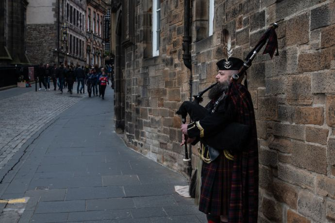 United Kingdom: Bagpipe player Scotland.  Photo by Garrett N More Info