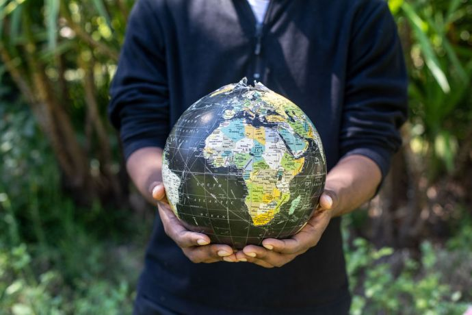 International: Hands hold a globe showing Africa. Photo by Rebecca Rempel More Info