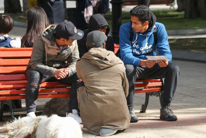 Argentina: Punta Arenas, Chile :: A student shares his faith in the street. More Info