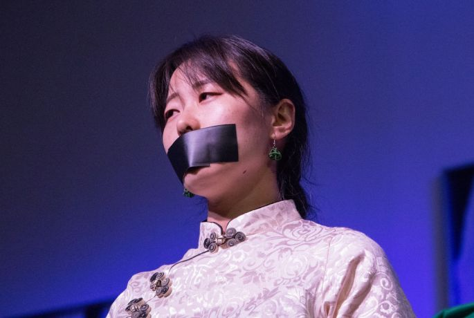 Argentina: Rosario, Argentina :: Eyan Ni (East Asia Pacific) roleplays a person who does not have free speech. More Info
