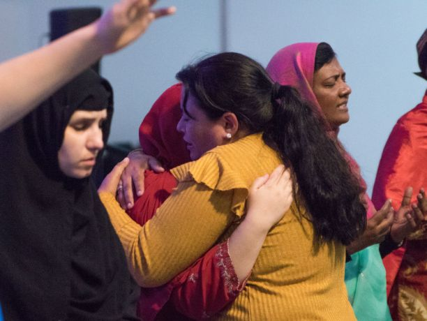 Argentina: Rosario, Argentina :: A women hugs Bethan Cannell (Isle of Man) during a prayer event. More Info