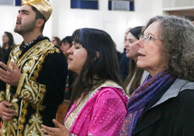 Argentina: Rosario, Argentina :: Otabek Kazykhodzhaev (Western and Central Asia), Camila Babativa (Colombia) and Teresa Penman (USA) sing during a church service. More Info