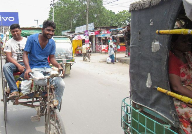 Bangladesh: Bangladesh :: Two men drive a tuk tuk on the street. More Info