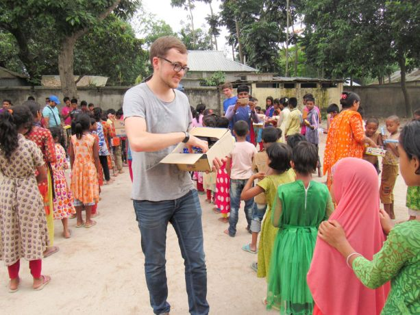 Bangladesh: Bangladesh :: Toby Gruber (Germany) gives food to children in a school. More Info