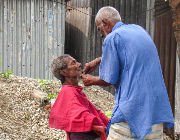 Bangladesh: Bangladesh :: A man shaves another person from his community in the street. More Info