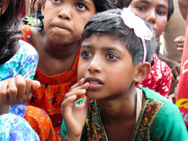 Bangladesh: Bangladesh :: A girl listens to a team of crewmembers during their visit. More Info