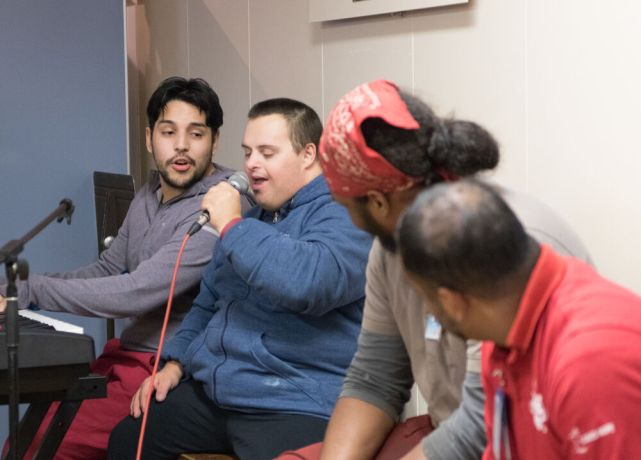 Argentina: Buenos Aires, Argentina :: A down syndrome man sings with the maintenance departement on the public deck. More Info