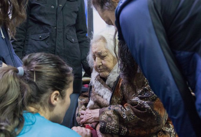Argentina: Buenos Aires, Argentina :: Ulyana Makarova (Russia) and Melisa Balliu (Albania) pray for an elderly woman. More Info