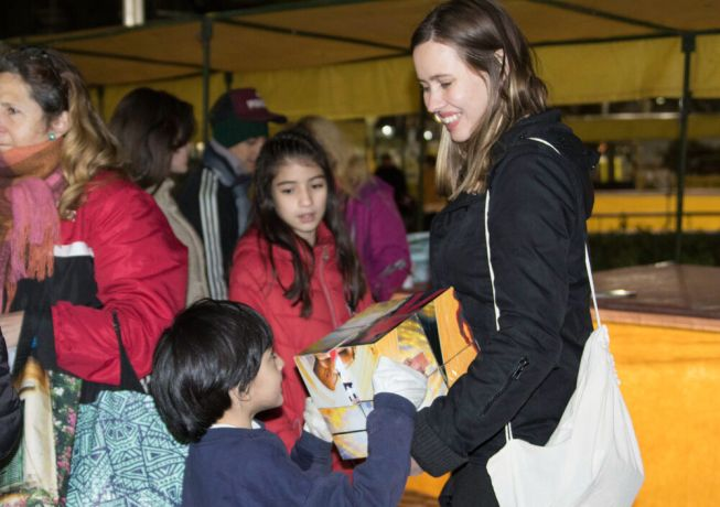 Argentina: Buenos Aires, Argentina :: Petra Sheane (Canada) connects with children during  feeding ministry with homeless people. More Info