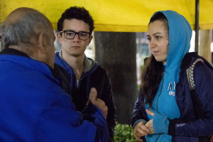 Argentina: Buenos Aires, Argentina :: Ulyana Makarova (Russia) chats with a man during feeding ministry with homeless people. More Info