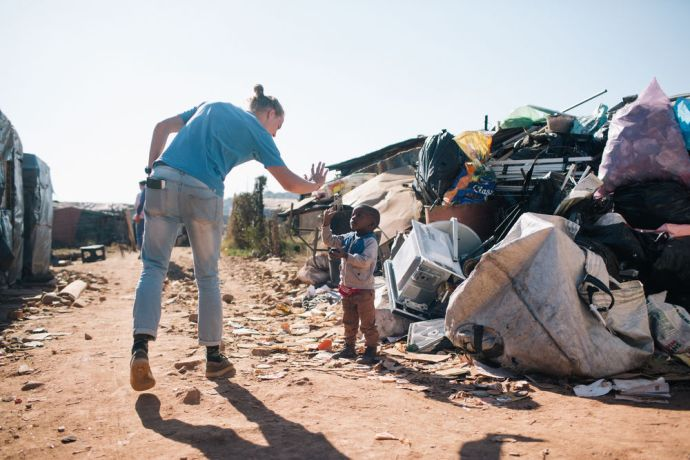 South Africa: South Africa MDT Trainee connects with a local child at Plastic view informal settlement. More Info