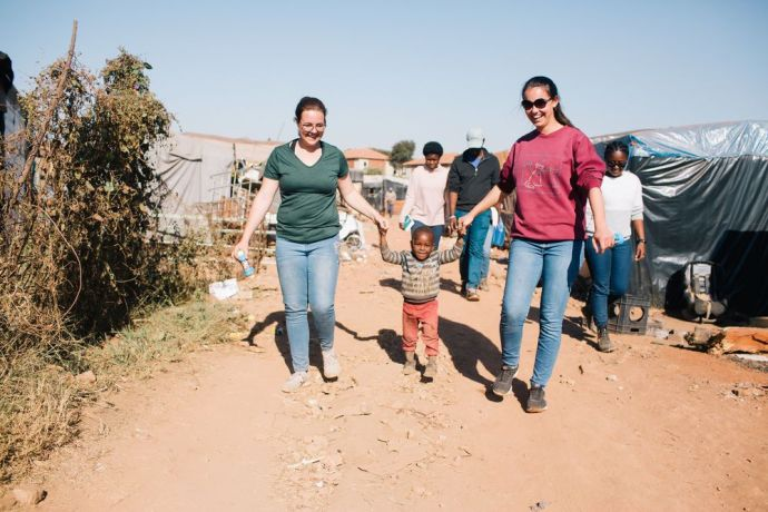 South Africa: South Africa MDT Trainees connect with a local child at Plastic view informal settlement. More Info