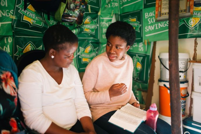South Africa: A South African MDT Trainee shares the gospel to a local woman. More Info