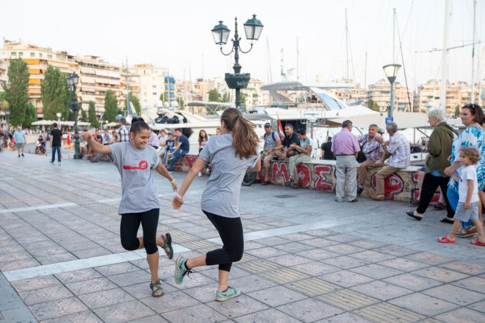 Greece: Participants of a dance outreach perform along the harbour in Athens. The outreach took place after Transform. Photo by Rebecca Rempel. More Info