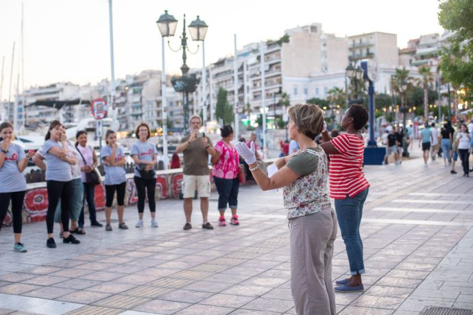 Greece: Participants of The Heartbeat of Athens outreach team perform a mime by the port. Photo by Rebecca Rempel. More Info