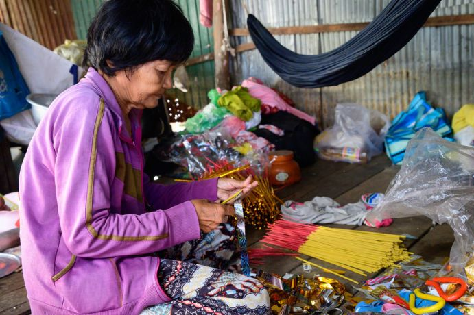 Cambodia: This woman is part of a Bible study OM runs. In her home, a gift from the local team, she makes sparklers which she sells, several hundred for a few cents. More Info