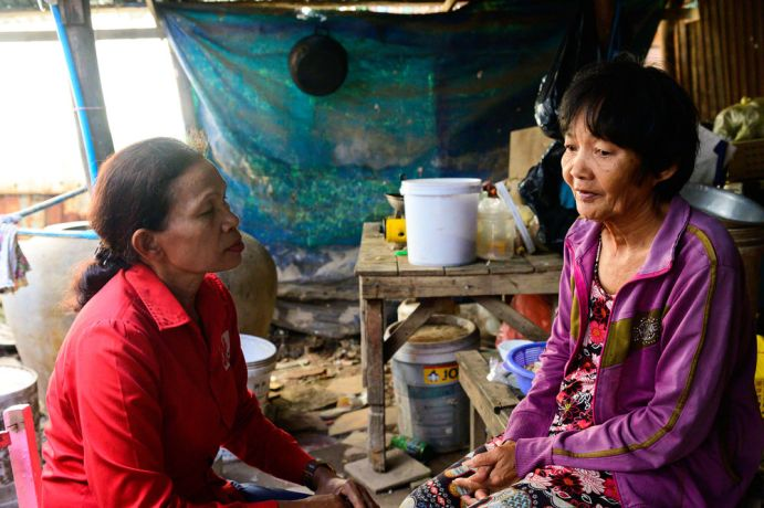 Cambodia: This woman is part of a Bible study OM runs. In her home, a gift from the local team, she talks to a team member who offers counseling and prayer. More Info