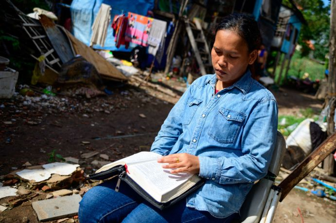 Cambodia: This woman is part of a Bible study OM runs who is taking time to read the Bible outside her home. More Info