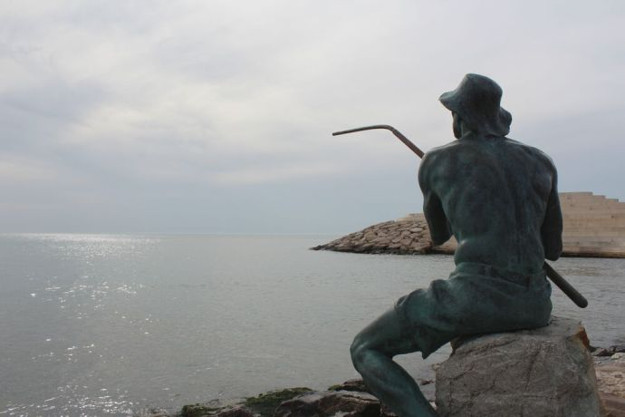 Albania: The fisherman statue stoically overlooking the Adriatic Sea in Durrës, Albania. More Info