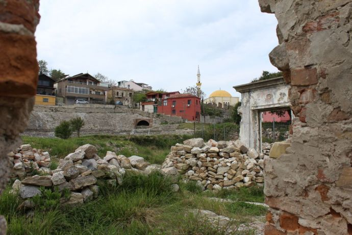 Albania: A famous archaeological site that was only discovered in the 1960s--the ancient amphitheatre in Durrës, Albanias second largest city. Here, the photographer looks out on the houses and mosque built close to the amphitheatre. More Info