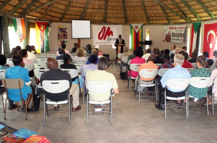 Zimbabwe: Tinashe Mafuta speaks at a mobilising event in Zimbabwe. Photo by Simon Marijani. More Info