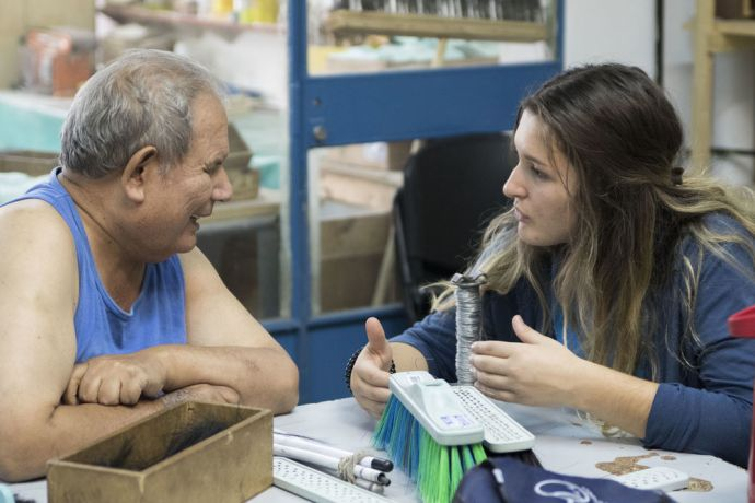 Argentina: Bahia Blanca, Argentina :: Melisa Balliu (Eastern Europe) chats with a man who is blind. More Info