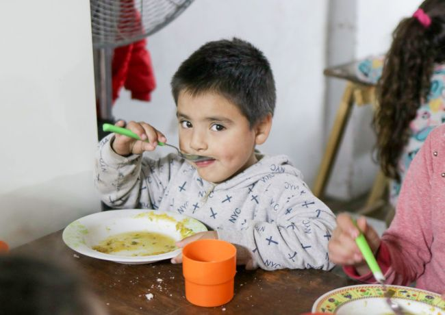 Argentina: Mar del Plata, Argentina :: A child eats lunch prepared by crewmembers on an onshore outreach. More Info