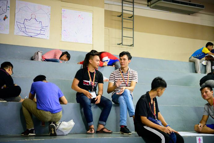 Malaysia: Baggio talking with a participant at TeenStreet KK. More Info