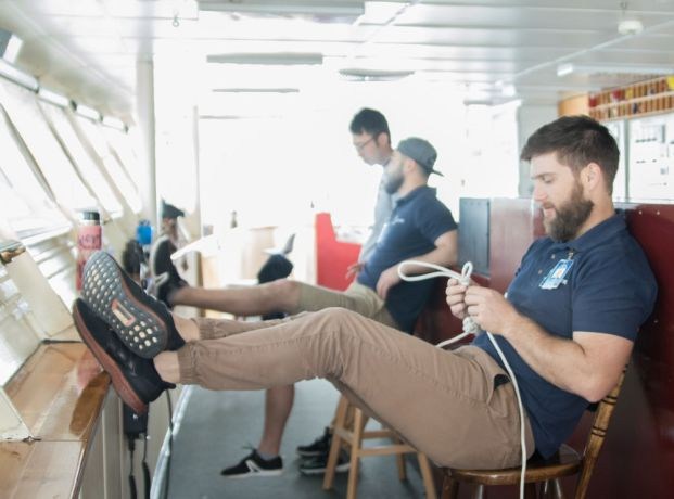 Argentina: Mar del Plata, Argentina :: Riaan Grobler (South Africa) ties a rope during his watch in the bridge. More Info