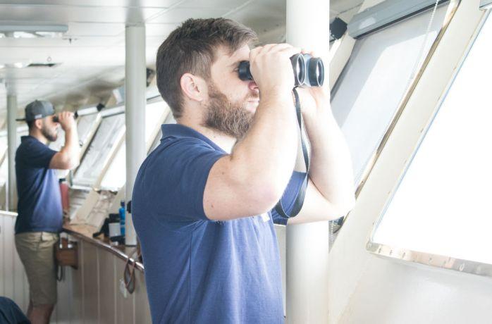 Argentina: Mar del Plata, Argentina :: Riaan Grobler (South Africa) looks in the binoculars in the bridge. More Info