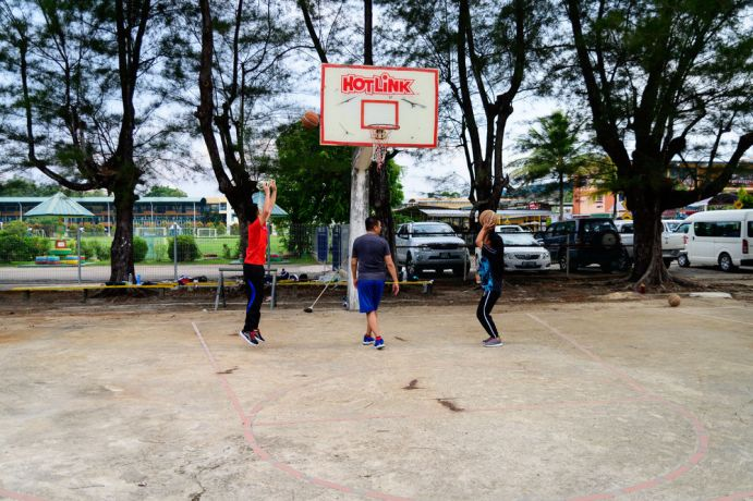 Malaysia: Shooting baskets during the basketball workshop. More Info