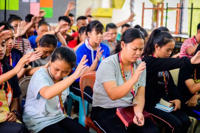 Malaysia: A group praying during a workshop. More Info