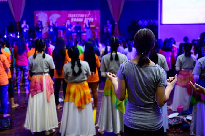 Malaysia: Praising the Lord during a worship session. More Info