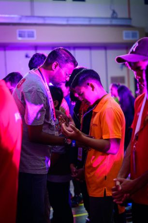 Malaysia: Staff praying with a participant during the Throne Room session. More Info
