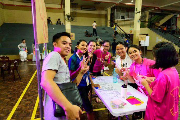 Malaysia: A group of participants having fun with origami. More Info