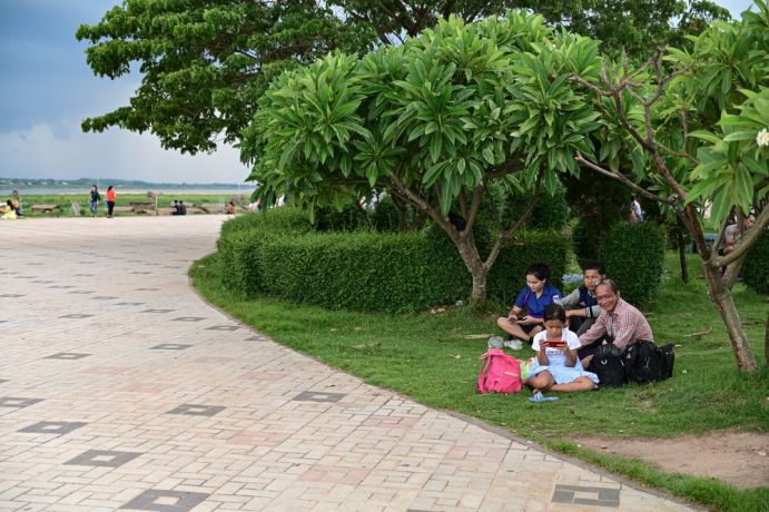 Laos: A family relaxing in the park. More Info