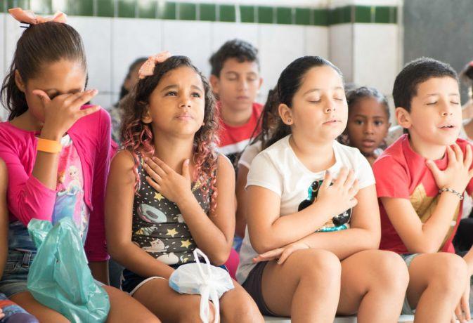 Brazil: Santos, Brazil :: Children from underprivileged neighbourhood pray at a kidsclub. More Info