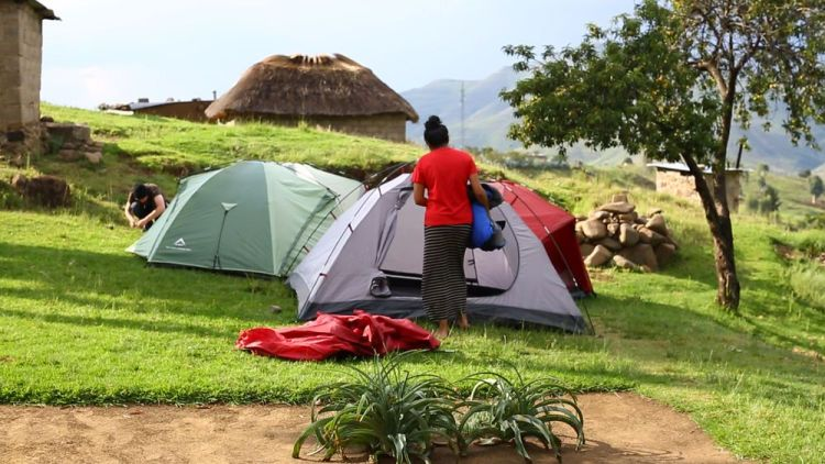 South Africa: Vinitha (Australia) sets up camp while on the Africa Trek. The Africa Trek is a discipleship programme that aims to disciple participants and equip them to become effective disciple-makers with a passion to reach out to those who do not know Christ's love. More Info