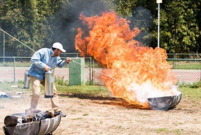 Brazil: Santos, Brazil :: Marko Hallidri (Albania) shows how to use an extinguisher. More Info