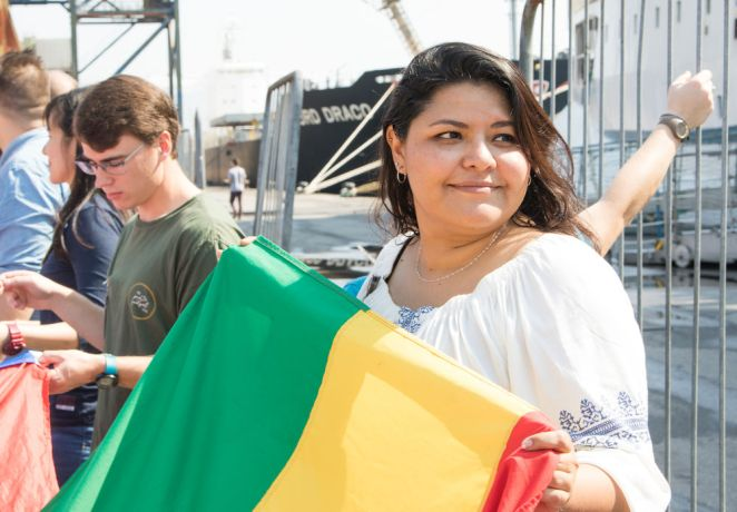 Brazil: Santos, Brazil :: Lorena Rios (Bolivia) welcomes new crewmembers at the flag tunnel. More Info