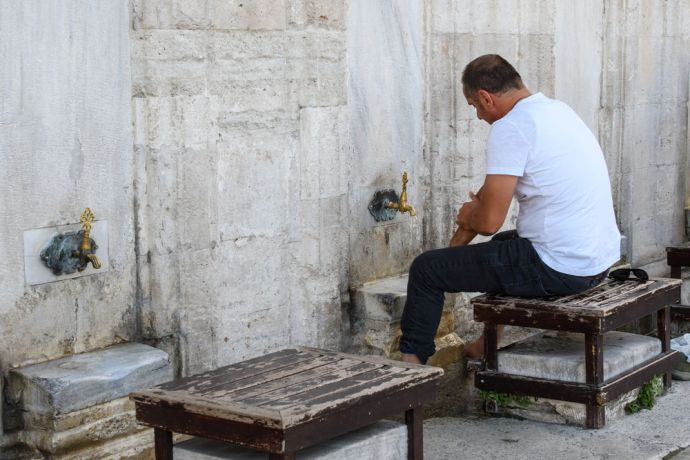 Turkey: Men performing ablutions before prayer at the mosque.  Photo by Garrett N More Info