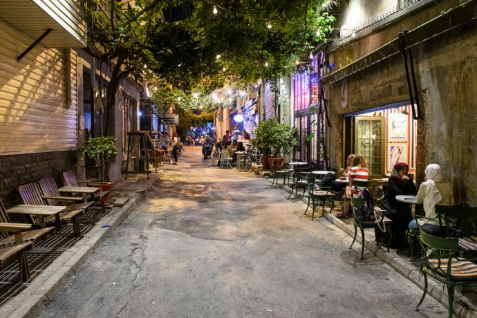 Turkey: People enjoying the evening air at restaurants and cafes in Istanbul Turkey.  Photo by Garrett N More Info