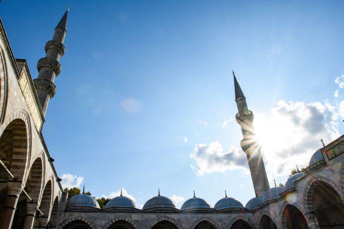 Turkey: Skyward view of the minarets of a mosque in Turkey.  Photo by Garrett N More Info