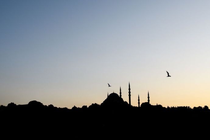 Turkey: Silhouette of a mosque in Turkey.  Photo by Garrett N More Info