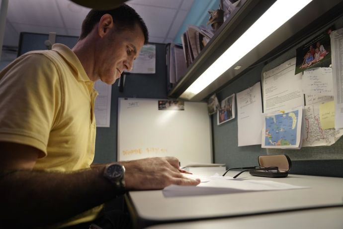 Jamaica: Matt in his office working through documents for OM in the Caribbean. photo by alex arpag More Info