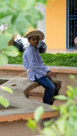 Panama: Panamanian boy wearing a traditional hat and playing a drum. More Info