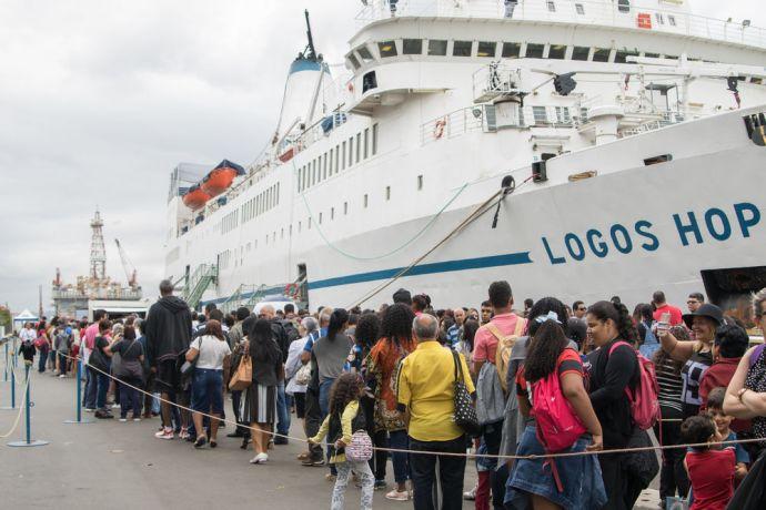 Brazil: Rio de Janeiro, Brazil :: Visitors wait on the quayside to enter  the bookfair. More Info