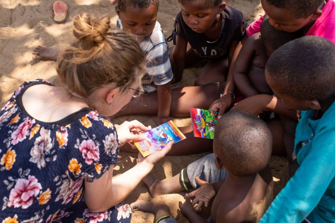 Namibia: A Luke 24 participants tells children a Bible story in a village.  The Luke 24 Journey is a month-long programme in Namibia that focuses on hearing God's voice and living by faith and obedience. With no set schedule, the group asks and trusts the Lord for direction and guidance. Photo by Rebecca Rempel More Info