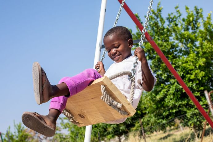 Namibia: A child plays on a swing at a preschool in Namibia. Photo by Rebecca Rempel More Info